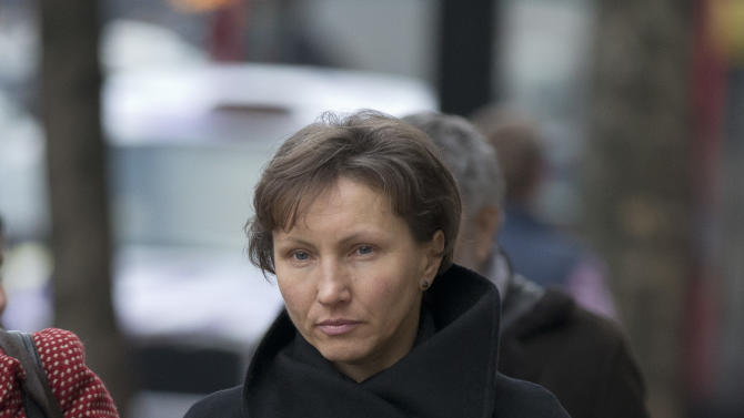 Marina Litvinenko, the widow of former Russian intelligence officer Alexander Litvinenko, arrives for the first day of a scheduled two-day Pre-Inquest Review at Camden Town Hall in London, Thursday, Dec. 13, 2012.  Alexander Litvinenko died in a London hospital in 2006, with the rare radioactive substance polonium-210 being found in his body.   (AP Photo/Matt Dunham)