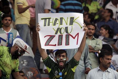 A Pakistani cricket fan holds up a placard during the Twenty20 Cricket match between Pakistan and Zimbabwe in Lahore