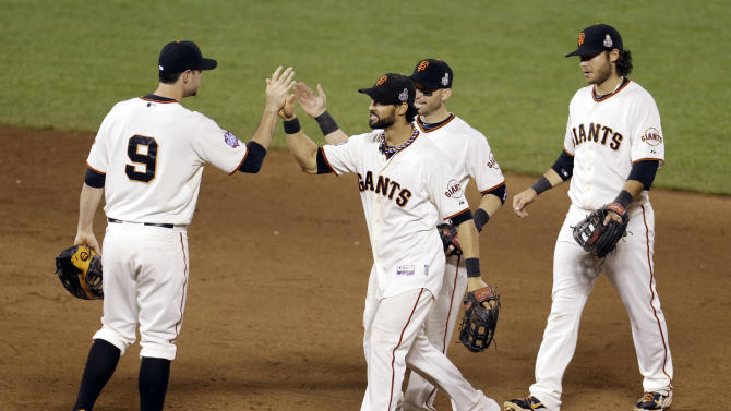 San Francisco Giants' Brandon Belt (9), Angel Pagan, Marco Scutaro and Brandon Crawford celebrate after Game 1 of baseball's World Series Wagainst the Detroit Tigers ednesday, Oct. 24, 2012, in San Francisco. The Giants won 8-3 to take a 1-0 lead in the series. (AP Photo/Eric Risberg)