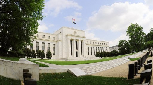 <p>The US Federal Reserve building is seen on July 30, 2009 in Washington, DC. Federal Reserve policymakers were divided over how long the central bank should continue asset purchases to support the economy, the minutes of their last meeting showed Thursday.</p>