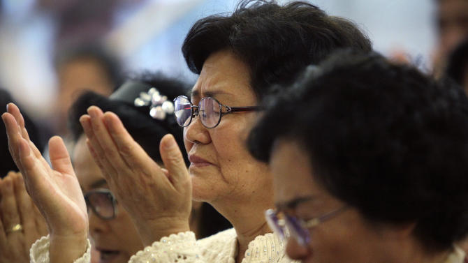 Followers pray for the Rev. Sun Myung Moon during a service at a Unification Church in Seoul, South Korea, Tuesday, Sept. 4, 2012. Moon, the self-proclaimed messiah who founded the church, died Monday at a church-owned hospital near his home in Gapyeong County, northeast of Seoul, church officials said. He was 92. (AP Photo/Hye Soo Nah)