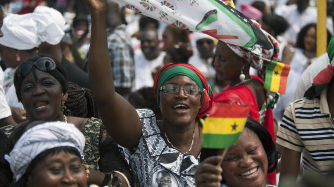 Supporters cheer during the inauguration ceremony for President John Dramani Mahama, at Independence Square in Accra, Ghana, Monday, Jan. 7, 2013. Ghana's President John Dramani Mahama was sworn in Monday for a new four-year term in the West African nation's capital of Accra after winning a closely fought election in December. (AP Photo/Gabriela Barnuevo)