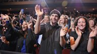 Supporters cheer as US President Barack Obama appears at a campaign event on October 5, at George Mason University in Fairfax, Virginia. Obama has stashed $181 million into his re-election account to cheer supporters after his limp debate performance, but several polls show movement towards Republican Mitt Romney