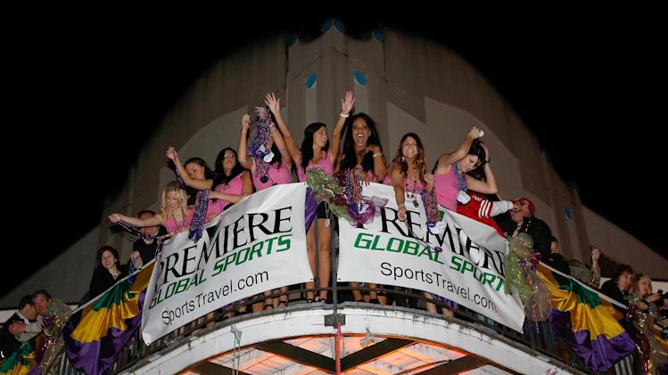 IMAGE DISTRIBUTED FOR PREMIERE SPORTS - The Premiere Girls can be seen throwing beads off the balcony at the Premiere Global Sports Balcony Over Bourbon Party in New Orleans, Louisiana on Friday, Feb. 1, 2013. (Scott Boehm /AP Images for PREMIERE GLOBAL SPORTS)