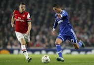 Schalke's Ibrahim Afellay (R) vies with Arsenal's Aaron Ramsey during their UEFA Champions League Group B match at the Emirates stadium in London. Schalke won 2-0