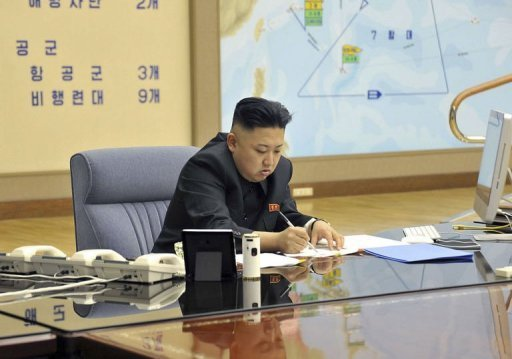 "This photo taken and released by North Korea's official Korean Central News Agency (KCNA) on March 29, 2013 shows North Korean leader Kim Jong-Un signing documents at an undisclosed location. North Korea announced Saturday that it had entered a ""state of war"" with South Korea and would deal with every inter-Korean issue accordingly."