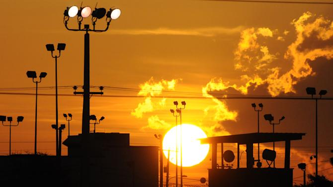In this photo reviewed by the U.S. Department of Defense, towers overlooking a U.S. detention facility are silhouetted against a morning sunrise at Guantanamo Bay U.S. Naval Base, Cuba, Thursday, Oct. 18, 2012.  Pre-trial hearings continue for five Guantanamo prisoners facing charges related to the Sept. 11, 2001 attacks, that include terrorism, conspiracy and murder. (AP Photo/Toronto Star, Michelle Shephard, Pool)