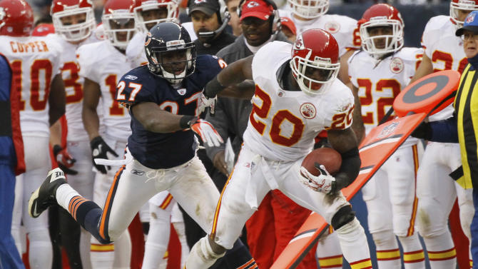 Kansas City Chiefs running back Thomas Jones (20) tries to fend off Chicago Bears safety Major Wright (27) in the first half of an NFL football game in Chicago, Sunday, Dec. 4, 2011. (AP Photo/Charles Rex Arbogast)