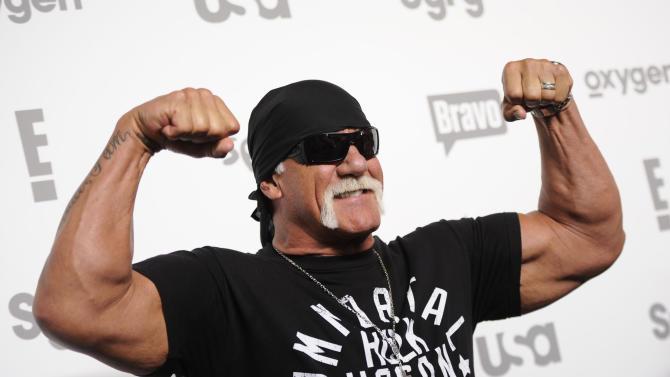 """FILE - In this May 14, 2015 file photo, Hulk Hogan attends the NBCUniversal Cable Entertainment 2015 Upfront at The Jacob Javits Center in New York. While speaking to TV critics Thursday, July 30, 2015, about his HBO series """"Ballers,"""" Dwayne Johnson was asked to comment on the tape of Hogan making racist comments. Johnson, also a former pro wrestler, said he was """"disappointed"""" when he heard about Hogan's remarks, but also said the comments didn't match his personal history with him. (Photo by Evan Agostini/Invision/AP, File)"""