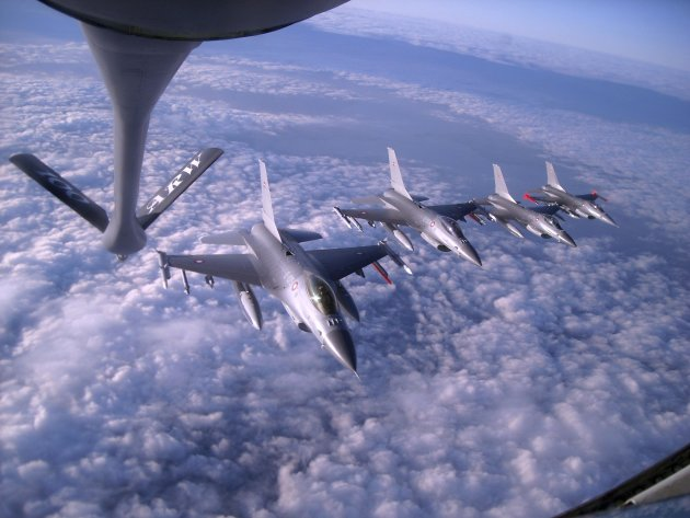 U.S. Air Force KC-135 Stratotanker assigned to 100th Air Refueling Wing prepares to fuel flight of Royal Danish Air Force F-16C Fighting Falcon aircraft in U.S. European Command over Britain