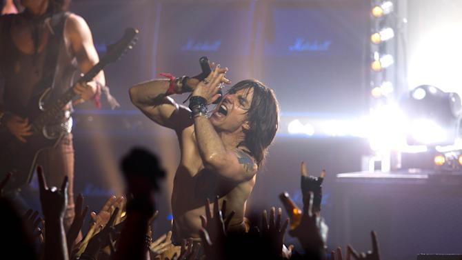 """This film image released by Warner Bros. Pictures shows Tom Cruise as Stacee Jaxx in New Line Cinema's rock musical """"Rock of Ages,"""" a Warner Bros. Pictures release. (AP Photo/Warner Bros. Pictures, David James)"""