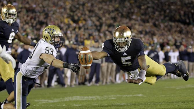 FILE - In this Nov.. 3, 2012, file photo, Notre Dame quarterback Everett Golson, right, dives into the end zone in front of Pittsburgh linebacker Joe Trebitz for a two-point conversion to tie the score late in the fourth quarter of an NCAA college football game in South Bend, Ind. Golson is doing a lot more of the little things right, and it's leading to more big plays for top-ranked Notre Dame. (AP Photo/Michael Conroy, File)