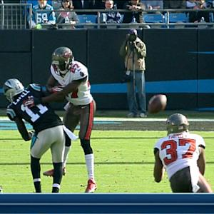 Tampa Bay Buccaneers safety Keith Tandy intercepts Carolina Panthers quarterback Cam Newton