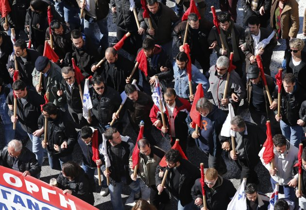 Members of pro-communist union PAME gather during a protest in Athens, Wednesday, Feb. 20, 2013. Unions have launched another general strike against austerity measures in Greece, amid predictions unem