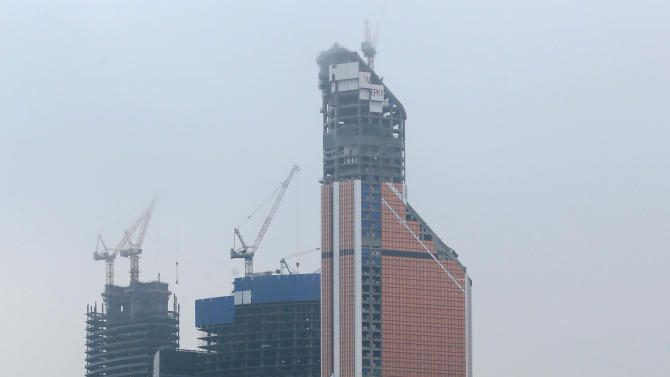 The Mercury City tower, right, is being constructed in Moscow, Russia, Thursday, Nov. 1, 2012. Moscow is reclaiming bragging rights for having Europe's tallest building after losing the distinction for a few months to London. The mixed office and residential tower called Mercury City has topped out at 338 meters (1,109 feet), officials of its development company said Thursday. (AP photo / Mikhail Metzel)