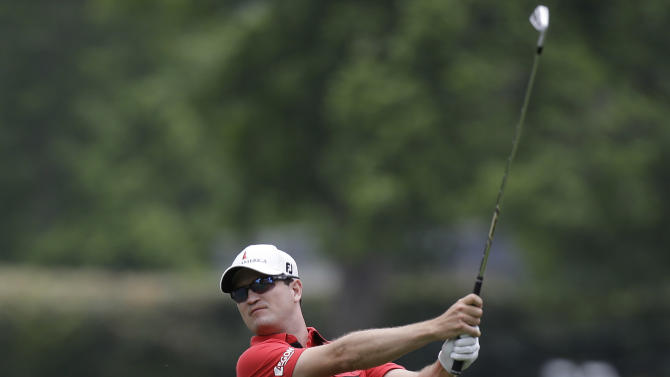Zach Johnson watches his approach shot on the fifth hole during the final round of the Colonial golf tournament on Sunday, May 25, 2013, in Fort Worth, Texas. (AP Photo/LM Otero)