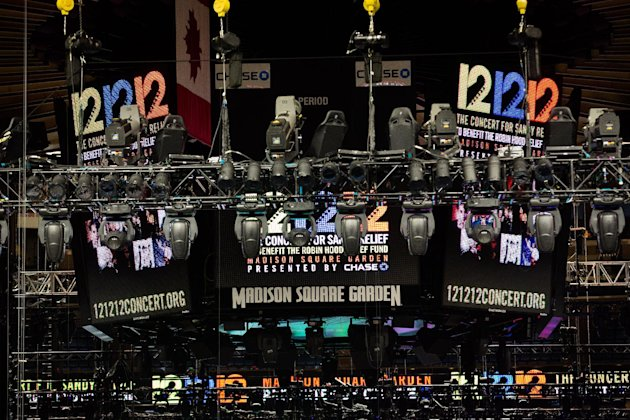 "Signage for the ""12-12-12"" concert is displayed on the Madison Square Garden jumbotron, Tuesday, Dec. 11, 2012, in New York. The Dec. 12 concert, whose proceeds will aid victims of Superstorm Sandy, will feature artists Bon Jovi, Eric Clapton, Dave Grohl, Billy Joel, Alicia Keys, Chris Martin, The Rolling Stones, Bruce Springsteen & the E Street Band, Eddie Vedder, Roger Waters, Kanye West, The Who and Paul McCartney. (AP Photo/John Minchillo)"