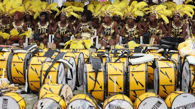 Performers sit near their drums  before the start of  Lagos Carnival in Lagos, Nigeria,  Monday, April 1, 2013. Performers filled the streets of Lagos' islands Monday as part of the Lagos Carnival, a major festival in Nigeria's largest city during Easter weekend. (AP Photo/Sunday Alamba)