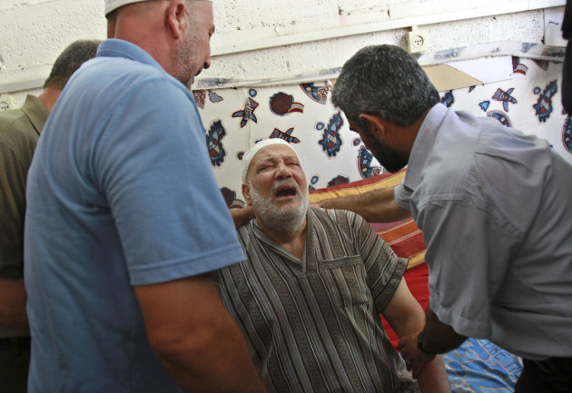 Palestinian Mohammed al-Dam grieves during the funeral of his son Mamon al-Dam, 14, in Gaza City, Thursday, June 21, 2012. Al Dam was killed on Wednesday during an Israeli air strike while he was playing at his family farm, Palestinians say. (AP Photo/Adel Hana)