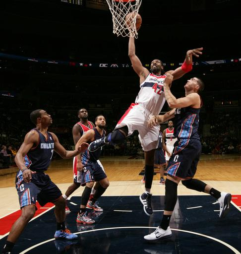 Bobcats keep Wizards winless with 108-106 2OT win