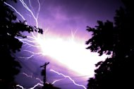 Lighting flashes Saturday morning, June, 30, 2012 in Hebron Md.. Violent storms swept across the eastern U.S., killing at least nine people and knocking out power to hundreds of thousands on a day that temperatures across the region are expected to reach triple-digits. (AP photo by Salisbury Daily Times, Kristin Roberts)