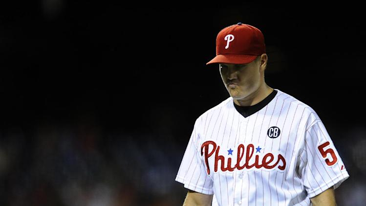 Philadelphia Phillies' Jonathan Papelbon walks off the field after giving up a solo home run to San Francisco Giants' Buster Posey to tie the game in the ninth inning of a baseball game on Tuesday, July 22, 2014, in Philadelphia. (AP Photo/Michael Perez)