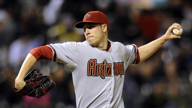 Arizona Diamondbacks starting pitcher Patrick Corbin throws to the plate against the Colorado Rockies during the seventh inning of a baseball game on Monday, May 20, 2013, in Denver. (AP Photo/Jack Dempsey)