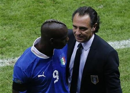 Italy's coach Prandelli talks to Balotelli after leaving the pitch during their Euro 2012 semi-final soccer match against Germany at the National Stadium in Warsaw
