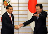 Peruvian President Ollanta Humala (L) is greeted by Japanese Prime Minister Yoshihiko Noda prior to their talks at Noda&#39;s office in Tokyo on May 9, 2012. Humala wrapped up a three-day visit to Japan Thursday, having secured up to $250 million worth of loans for infrastructure projects