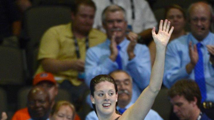 Allison Schmitt waves after winning the women's 200-meter freestyle final at the U.S. Olympic swimming trials, Thursday, June 28, 2012, in Omaha, Neb. (AP Photo/Mark J. Terrill)