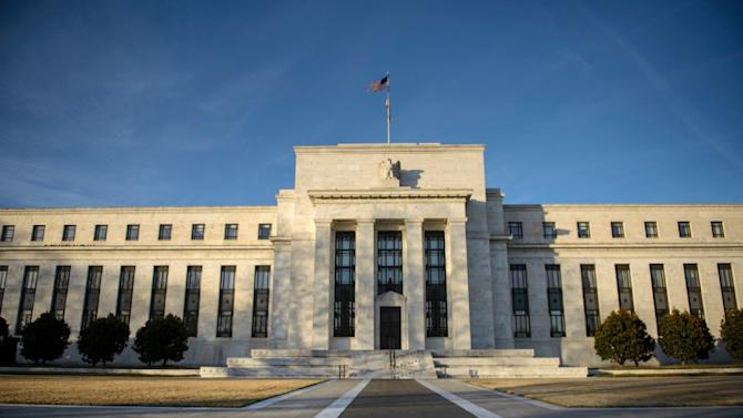 The Federal Reserve (pictured) was expected to pause on its path toward launching a series of rate hikes as a two-day monetary policy meeting opened in Washington Tuesday