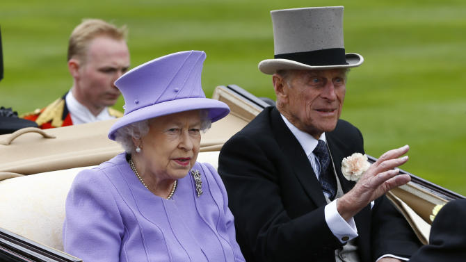 Britain's Queen Elizabeth II arrives with Prince Philip by carriage in the parade ring on the fourth day of Royal Ascot horse race meeting at Ascot, England, Friday, June  22, 2012. (AP Photo/Alastair Grant)