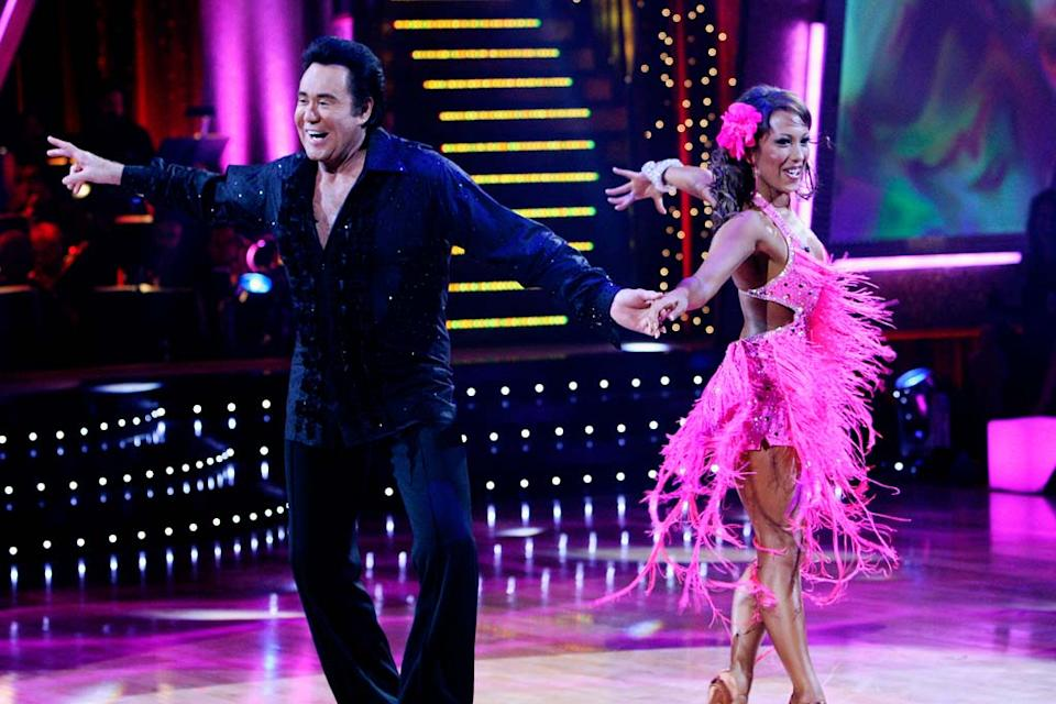 Wayne Newton and Cheryl Burke perform a dance in the 5th season of Dancing with the Stars.