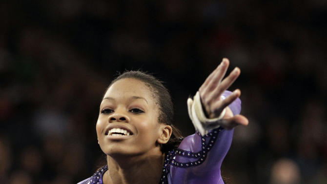 Gabrielle Douglas competes during the floor exercise portion of the American Cup gymnastics meet at Madison Square Garden in New York, Saturday, March 3, 2012. (AP Photo/Kathy Willens)