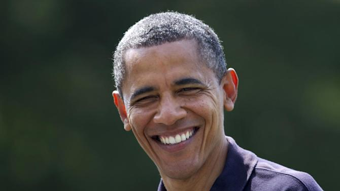 President Barack Obama smiles as he returns to the White House in Washington, Sunday, July 8, 2012, from Camp David, Md.  (AP Photo/Manuel Balce Ceneta)