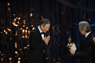 "Director Ang Lee accepts the Oscar for Best Director from actor Michael Douglas at the 85th Annual Academy Awards on February 24, 2013 in Hollywood, California. Taiwan basked in reflected glory after Lee won the best director Oscar for fantasy epic ""Life of Pi"", which he shot on the diplomatically isolated island where he was born"