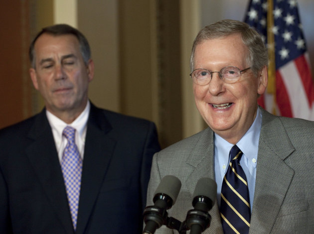 House Speaker John Boehner, R-Ohio, and Senate Minority Leader Mitch McConnell, R-Ky., appear at a news conference as the debt crisis goes unresolved on Capitol Hill in Washington, Saturday, July 30, 2011.(AP Photo/Harry Hamburg)