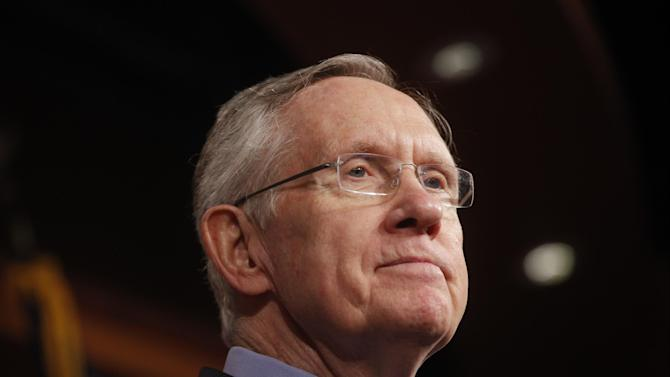 Senate Majority Leader Harry Reid of Nevada, listens to a reporter's question about their meeting with Senate Republicans regarding the government shutdown and debt ceiling on Capitol Hill in Washington, Saturday, Oct. 12, 2013. (AP Photo/Charles Dharapak)