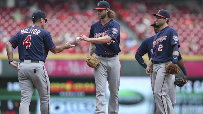 Minnesota Twins relief pitcher Aaron Thompson, center, is relieved in the seventh inning of a baseball game against the Cincinnati Reds, Wednesday, July 1, 2015, in Cincinnati. The Reds won 2-1. (AP Photo/John Minchillo)