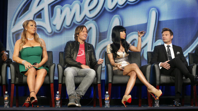 "Mariah Carey, Keith Urban, Nicki Minaj and Ryan Seacrest from ""American Idol"" attend the Fox Winter TCA Tour at the Langham Huntington Hotel on Tuesday, Jan. 8, 2013, in Pasadena, Calif. (Photo by Todd Williamson/Invision/AP)"