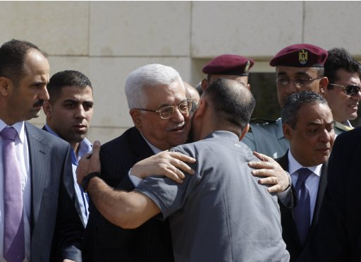 Palestinian President Abbas greets a newly released Palestinian prisoner during a welcoming ceremony in Ramallah