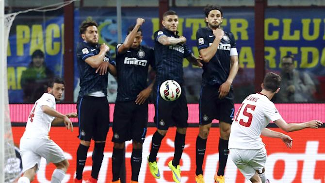 AS Roma's Pjanic shoots a free kick against Inter Milan during their Serie A soccer match at the San Siro stadium in Milan