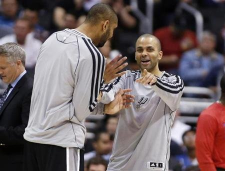 San Antonio Spurs' Parker and Duncan share a laugh against the Los Angeles Clippers during their NBA game in Los Angeles
