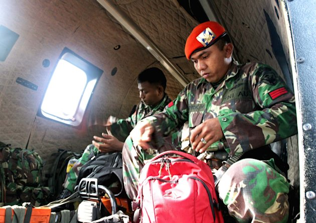 Indonesian Air Force jumper prepare their gear before departing on a rescue mission to the site where a Russian-made Sukhoi Superjet-100 plane crashed, at their base in Pasir Pogor, West Java, Indonesia, Friday, May 11, 2012. Rescue teams used climbing gear to scale the nearly sheer slopes of a dormant Indonesian volcano, hoping Friday to reach the wreckage of a Russian-made jetliner that crashed with 45 people aboard during a demonstration flight for potential buyers. (AP Photo)