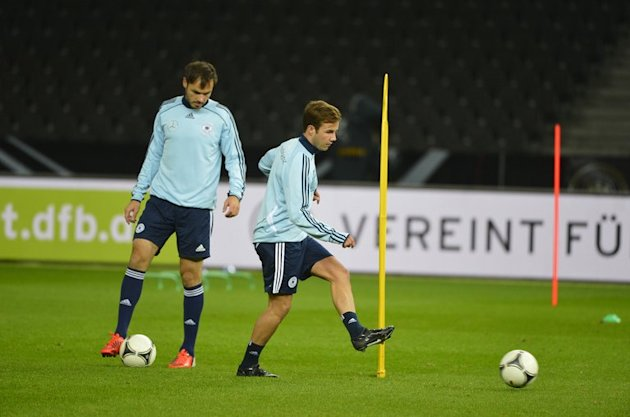 Mats Hummels (left) and Mario Goetze take part in a training session at Berlin's Olympic Stadium, on October 15, 2012