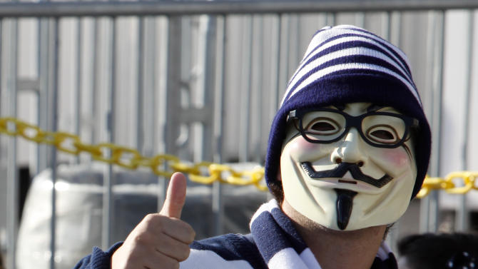 A student wears a mask and Joe Paterno style glasses as he waits to get in Penn State's Beaver Stadium before their game with the University of Nebraska Saturday, Nov. 12, 2011 in State College, Pa. Penn State is playing for the first time in decades without former head coach Joe Paterno, after he was fired in the wake of a child sex abuse scandal involving a former assistant coach. (AP Photo/Alex Brandon)