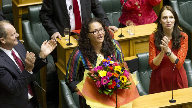 New Zealand lawmaker Louisa Wall, center, who sponsored the gay marriage bill is congratulated by Labour leader Davis Shearer, left, and MP Jacinda Ardern after the Marriage Amendment Bill was passed at Parliament in Wellington, New Zealand Wednesday, April 17 2013. Hundreds of jubilant gay-rights advocates celebrated at New Zealand's Parliament on Wednesday as the country became the 13th in the world and the first in the Asia-Pacific region to legalize same-sex marriage. (AP Photo/Mark MItchell) AUSTRALIA OUT, NEW ZEALAND OUT