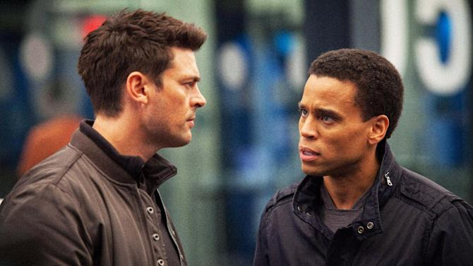 """In this undated publicity photo released by FOX, Karl Urban, left, as John Kennex and Michael Ealy as Dorian partner to fight crime in the year 2048 in the new FOX drama, """"Almost Human,"""" premiering this fall on FOX.  (AP Photo/FOX, Liane Hentscher)"""