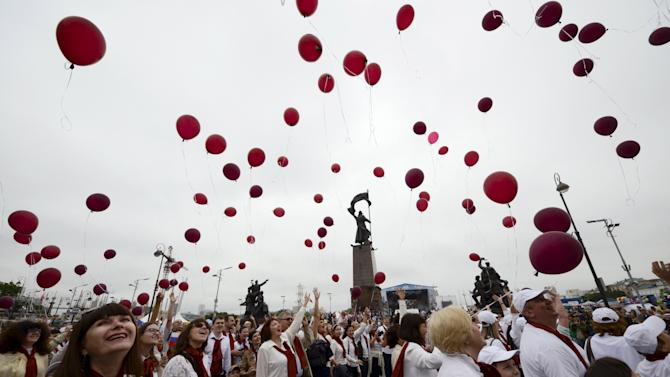 People release balloons during celebrations for the 155th anniversary of the far eastern city of Vladivostok