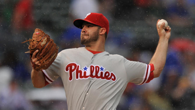 Philadelphia Phillies starter Adam Morgan delivers a pitch during the first inning of a baseball game against the Chicago Cubs Friday, May 27, 2016, in Chicago. (AP Photo/Paul Beaty)